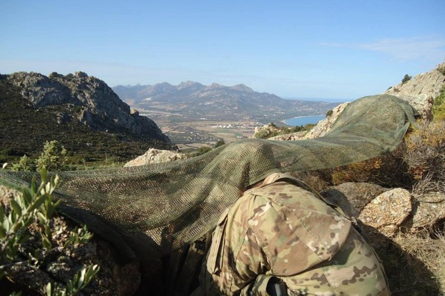 U.S. Army snipers from the 173rd Airborne Brigade scout a target during combined Exercise Kepi Blanc, with the French Foreign Legion, Calvi, France, Sept. 8, 2015.