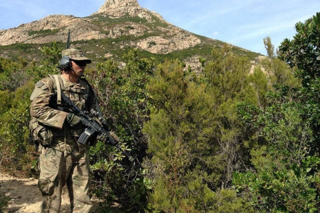 A U.S paratrooper, from the 173rd Airborne Brigade, scouts a target during combined Exercise Kepi Blanc with the French Foreign Legion in Calvi, France, Sept. 8, 2015.