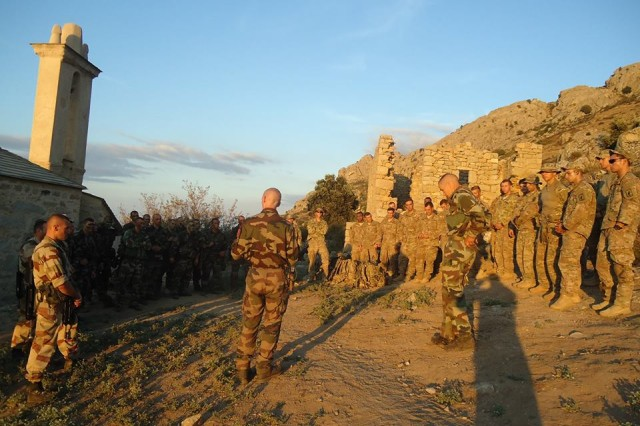 U.S. Army and French Foreign Legion paratroopers discuss a mission plan during combined Exercise Kepi Blanc with the French Foreign Legion in Calvi, France, Sept. 8, 2015.