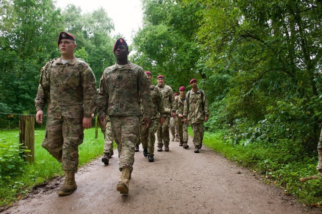 Paratroopers from the 173rd Airborne Brigade, continue their march from Oosterbeek cemetery Sept. 17, during a commemorative road march to pay tribute to those who jumped here as part of Operation Market Garden 71 years ago. The commemoration brought together approximately 1,000 allied paratroopers from the U.S., Belgium, Germany, Italy, the Netherlands, Poland and the U.K. for several days of combined airborne operations and ceremonies. Market Garden was the largest airborne operation in history, taking place from Sept. 17-25, 1944. The march led paratroopers a total of 17 kilometers from the Ginkel Memorial to the Frost Bridge, both key locations during the exercise. (U.S. Army photo by Sgt. Daniel Cole, U.S. Army Europe Public Affairs)