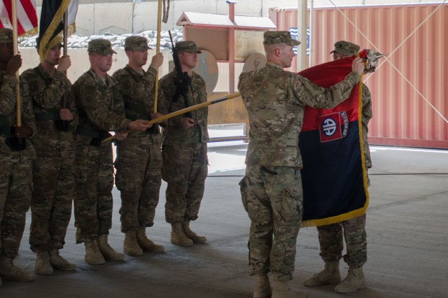 Col. Curtis Buzzard, commander of the 3rd Brigade Combat Team, 82nd Airborne Division, along with Command Sgt. Maj. Daniel Gustafson, case the unit's colors in a transfer-of-authority ceremony in Baghdad, Sept. 17, 2015.