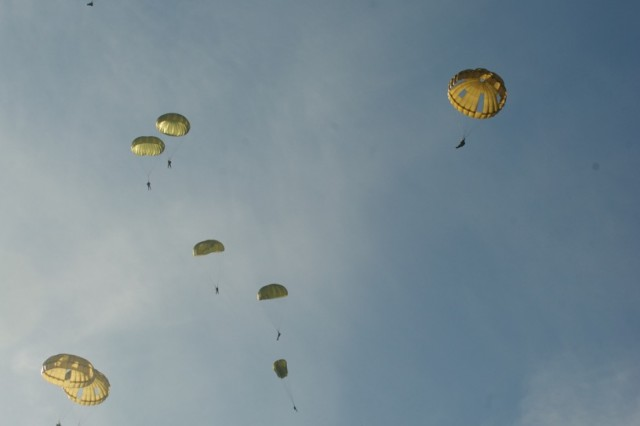 HOUTDORPERVELD DROP ZONE, the Netherlands - U.S., Belgian, German, Italian, Dutch, Polish and British paratroopers jump from a Dutch C-130H Sept. 18, 2015, at  Houtdorperveld Drop Zone, the Netherlands as part of the 71st anniversary of Operation Market Garden. The commemoration brought together approximately 1,000 allied paratroopers from the seven NATO nations for several days of combined airborne operations and ceremonies. Market Garden was the largest airborne operation in history, taking place from Sept. 17-25, 1944. (U.S. Army photo by Sgt. Daniel Cole, U.S. Army Europe Public Affairs)