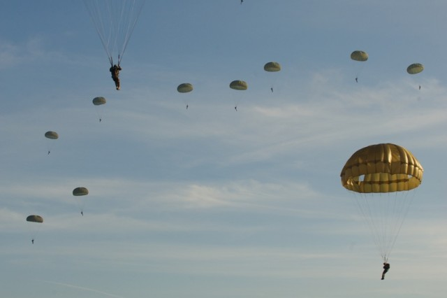 HOUTDORPERVELD DROP ZONE, the Netherlands - Paratroopers from the U.S., U.S., Belgium, Germany, Italy, the Netherlands, Poland and the U.K conduct an airborne operation Sept. 18, 2015, at Houtdorperveld Drop Zone, the Netherlands as part of the 71st anniversary of Operation Market Garden 71 years ago. The commemoration brought together approximately 1,000 allied paratroopers from the seven NATO nations for several days of combined airborne operations and ceremonies. Market Garden was the largest airborne operation in history, taking place from Sept. 17-25, 1944.