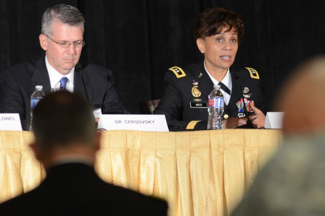 "Maj. Gen. Nadja West, staff surgeon for the Joint Staff at the Pentagon, chairs a panel at the Association of the U.S. Army's ""Hot Topics"" seminar to discuss ""Enabling Health Readiness in a Complex World."" Dr. Steven Cersovsky, left, science advisor at the Army Public Health Center (Provisional), at Aberdeen Proving Ground, Md., discussed the problems of climate change."