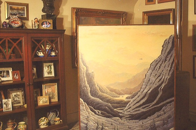 Dennis Bacceschi's most recent completed painting, a mountain landscape, on display in his home. The bust on the cabinet to the left of the painting is a self-portrait by Bacceschi's uncle, Angelo Gepponi, who served as a cook in the U.S. Army during World War II, and would use his art to document daily life in the Pacific theater. Baccheschi had a close relationship with his uncle, who would critique his nephew's work and give him pointers.