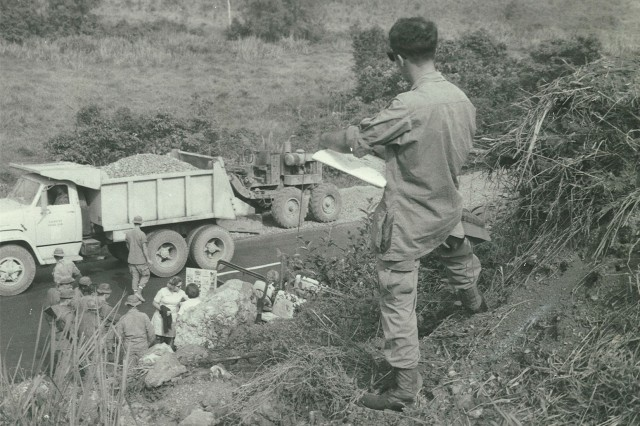 Former Spc. 4 Dennis Baccheschi sketches a scene while deployed in Vietnam. Baccheschi was employed as a combat artist with the Corps of Engineers, 18th Engineer Brigade, in 1969.