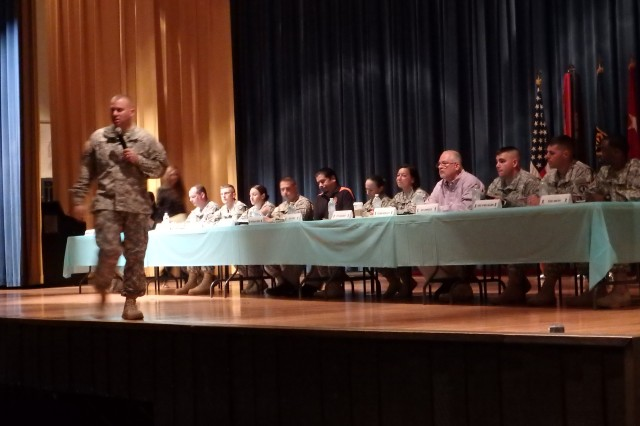 Military and civilian panel members from a variety of experience and leadership levels speak at the SHARP summit in Baker Theater Sept. 18.