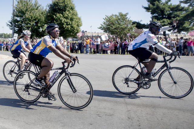 Along Screaming Eagle Boulevard at Fort Campbell, throngs of spectators cheer on cyclists on the final stretch of the 3rd Annual Bluegrass Rendezvous Bike Ride from Fort Knox to Fort Campbell.