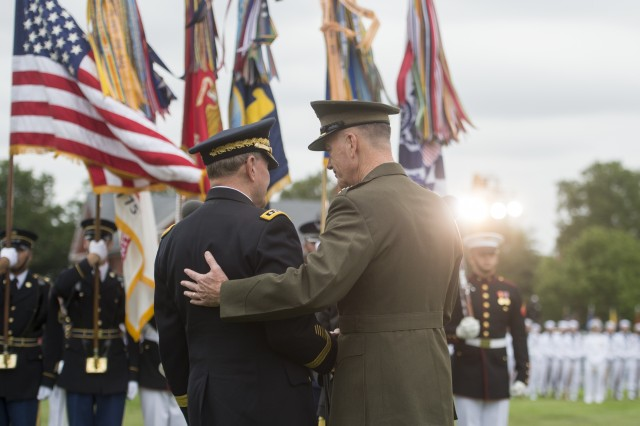 U.S. Marine Gen. Joseph F. Dunford Jr., the 19th chairman of the Joint Chiefs of Staff and the 18th chairman of the Joint Chiefs of Staff U.S. Army Gen. Martin E. Dempsey, on Summerall Field, Joint Base Myer-Henderson Hall, Arlington, Va., Sept. 25, 2015.