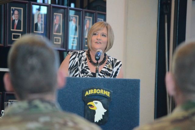 Cindy Stonebraker, daughter of Air Force Lt. Col. Kenneth Stonebraker who went missing on Oct. 28, 1968, speaks during the POW/MIA Recognition Day ceremony at McAuliffe Hall, Sept. 18, 2015.