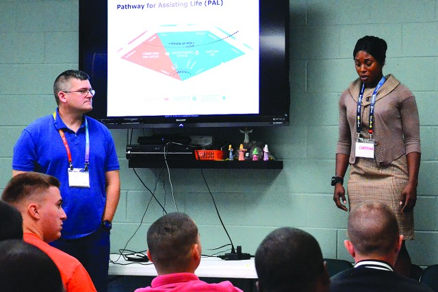 "Staff Sgt. Randall Winsett, 101st Airborne Division Sustainment Brigade chaplain assistant, leads Applied Suicide Intervention Skills Training with help from Staff Sgt. Natasha Taylor, a 74th Transportation Company platoon sergeant. The pair invited the Soldiers attending to engage in a hypothetical scenario where a suicidal woman threatened to jump off a bridge. ""I believe it puts the Soldiers in the moment,"" Winsett said of the mandated training."