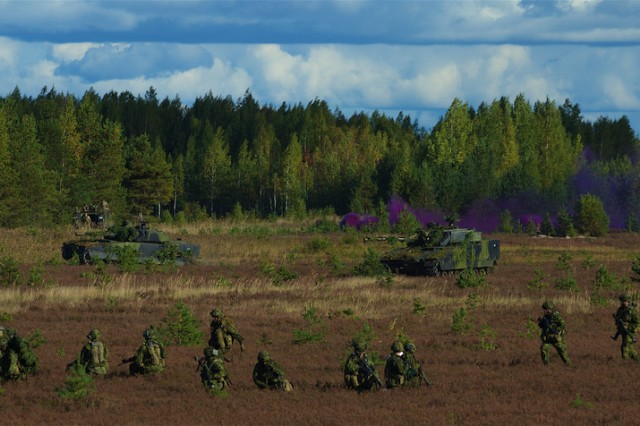 Infantry soldiers, from the Canadian army, and CV-90 Combat Vehicles from 2nd Armored Infantry Battalion, 1st Brigade, Royal Danish Army, maneuver during a situational training exercise as part of Silver Arrow 2015 in Adazi, Latvia, Sept. 27, 2015.