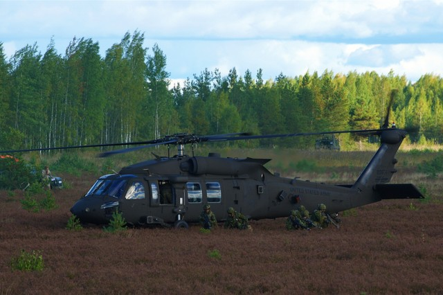 Infantry soldiers from the Canadian army pull security after dismounting a UH-60 Black Hawk from the 3rd Combat Aviation Brigade, 3rd Infantry Division out of Hunter Army Airfield, Ga., during a situational training exercise as part of Silver Arrow 2015 DV Day held in Adazi, Latvia, Sept. 27, 2015. Silver Arrow is a Latvian-led cooperative training exercise with Denmark, Canada, Germany, the U.S. and the U.K. There are more that 1,000 participant and the exercise is designed to improve cooperation among NATO member states.