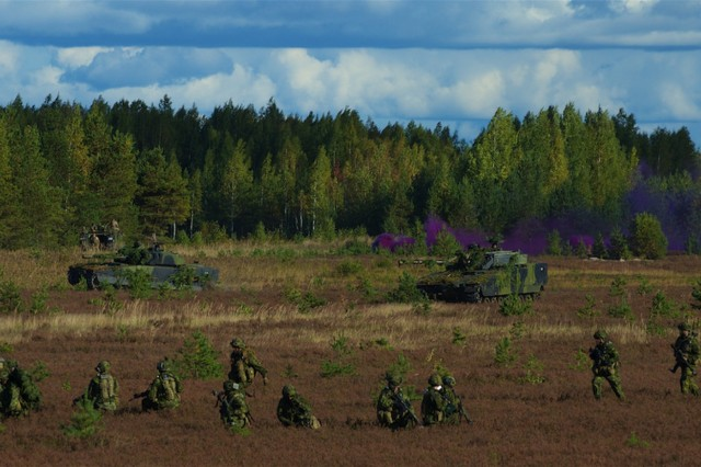 Infantry soldiers from the Canadian army and CV-90 Combat Vehicles from 2nd Armored Infantry Battalion, 1st Brigade, Royal Danish Army, maneuver during a situational training exercise as part of Silver Arrow 2015 DV Day held in Adazi, Latvia, Sept. 27, 2015. Silver Arrow is a Latvian-led cooperative training exercise with Denmark, Canada, Germany, the U.S. and the U.K. There are more that 1,000 participant and the exercise is designed to improve cooperation among NATO member states.