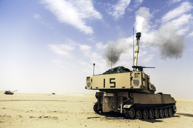 A Paladin M109A6 self-propelled howitzer, which is assigned to Battery B, 3rd Battalion, 16th Field Artillery Regiment, 2nd Armored Brigade Combat Team, 4th Infantry Division, fires an 155mm artillery shell during a live fire at the Udairi Range Complex on Camp Buehring, Kuwait, March 19, 2014. The unit trained on various indirect and direct fire missions during the live fire.