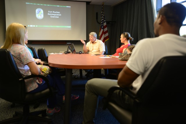 Doug Sanders, the director of personnel recovery for U.S. Army South, explains a portion of the reintegration process to family member of Survival, Evasion, Resistance and Escape school students Sept. 18 at Fort Rucker, Alabama. The family members participated in a post-isolation reintegration exercise hosted by U.S. Army South Sept. 15-21.