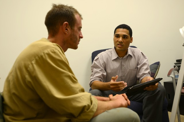 Sgt. Miguel Casillasgarcia (right), a de-briefer assigned to the 470th Military Intelligence Battalion, speaks with 2nd Lt. William Morgan, a recent Survival, Evasion, Resistance and Escape school graduate, Sept. 18 at Fort Rucker, Alabama. Morgan was one of five SERE students who volunteered to participate in a post-isolation reintegration exercise hosted by U.S. Army South Sept. 15-21.