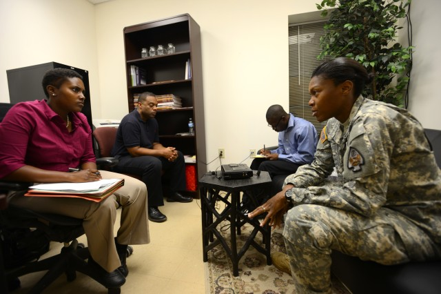 Spc. Cameil Mighty (right), a recent Survival, Evasion, Resistance and Escape school graduate, speaks with Spc. Toni Sledge (left), a de-briefer assigned to the 470th Military Intelligence Battalion, Sept. 20 at Fort Rucker, Alabama. Mighty was one of five SERE students who volunteered to participate in a post-isolation reintegration exercise hosted by U.S. Army South Sept. 15-21.