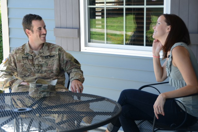 Warrant Officer Joshua Bone, a recent Survival, Evasion, Resistance and Escape school graduate, shares a laugh with his wife, Alyssa Bone, shortly after being reunited Sept. 20 at Fort Rucker, Alabama after three weeks apart. Bone was one of five SERE students who volunteered to participate in a post-isolation reintegration exercise hosted by U.S. Army South Sept. 15-21.