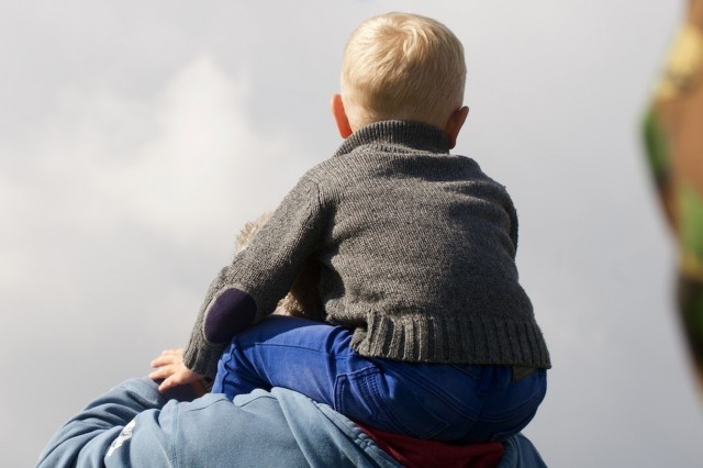 A young Dutch sits on his father's shoulders and watches a Dutch aircraft deliver paratroopers from the U.S., Belgium, Germany, Italy, the Netherlands, Poland and the U.K jump Sept. 19, as part of a commemorative event held to remember Operation Market Garden. local The event, which marked the 71st anniversary of Operation Market Garden, the largest Airborne jump in history, hosted attendees who outlined more than a kilometer of the drop zone's border. Many surrounded the Airborne Monument in Ginkel Heide, which stands for Market Garden's fallen paratroopers, overlooking the historic drop zone in the town of Ede. The commemoration brought together approximately 1,000 allied paratroopers from the seven NATO allies for several days of combined airborne operations and ceremonies. Market Garden was the largest airborne operation in history, taking place from Sept. 17-25, 1944.