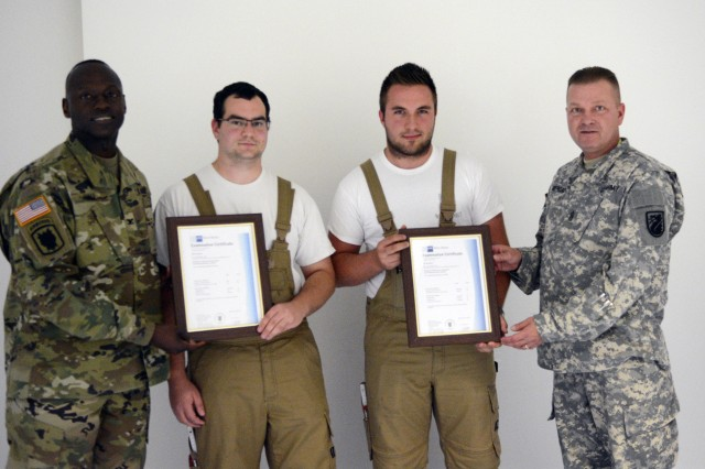Two Germans complete three-year IT apprentice program, three more begin 