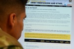 "A Soldier looks at the Army's new website, ""Not In My Squad Assessment Resource,"" a tool designed to help improve squad leaders' professional development and make good squads even greater."