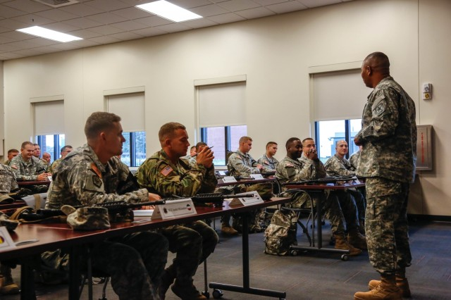 U.S. Army Sgt. Maj. Steven Payton, HQDA G3/5/7 sergeant major, gives an incoming brief to the competitors of the U.S. Army's Best Warrior Competition at Fort A.P. Hill, Va.,  Oct. 4, 2015. The competition is a grueling, week-long event that tests the skills, knowledge, and professionalism of 26 warriors representing 13 commands.