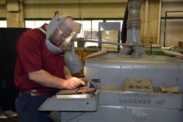 Apprentice Travis Flanigan making his first cut.
