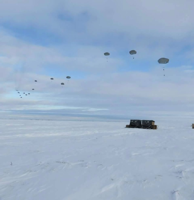 Supplies land in the snow of the Artic Circle