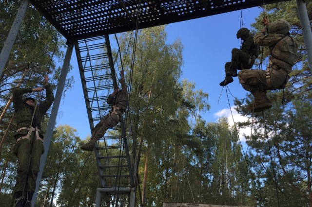 U.S. and Lithuanian combat engineers rapel as part of a combined Best Sapper Competition, hosted by the 173rd Airborne Brigade in Rukla, Lithuania, Sept. 29, 2015.