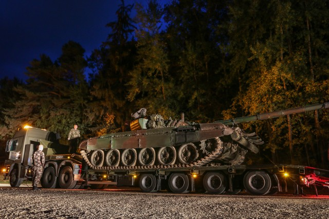 Slovenian mechanics prepare an M-84 Main Battle Tank for movement to the Joint Multinational Readiness Center in Hohenfels, Germany Oct. 6, 2015.  (U.S. Army photo by Sgt. 1st Class Caleb Barrieau)