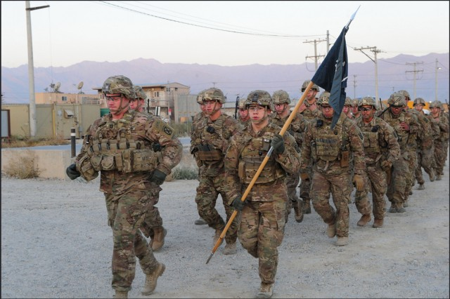 Capt. Dave Judson, commander, B Company, 2nd Battalion, 14th Infantry Regiment, leads his company formation during the deployed battalion's Mogadishu Mile ceremony, Oct. 3, 2015.
