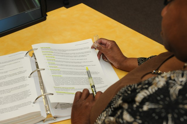 A student highlights information in her textbook during the six-week professional Human Resources preparatory HR certification course held last month.