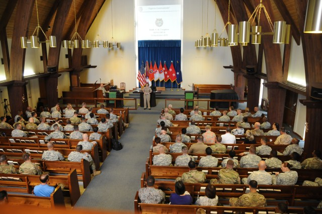 Rear Admiral Kathleen M. Creighton, Director for Command, Control, Communications and Cyber, U.S. Pacific Command, speaks to an audience comprised of Signaleers about the importance of join operations during the Communicators Forum at the Wheeler Army Air Force Chapel, Sep. 15, 2015.