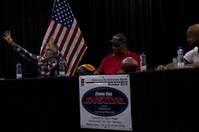 "Zackery Mueller, information technology specialist with USARCENT network security office, does his explosion effect during the show ""From the Inside"" at Camp Arifjan, Kuwait, Oct. 7, 2015. Mueller's character is the comedian on the show. The title and focus of the second episode was Privileged Access, which is defined as the delegation of authority over a computer system.  (U.S. Army photo by Sgt. Youtoy Martin, 19th Public Affairs Detachment, USARCENT Public Affairs)"