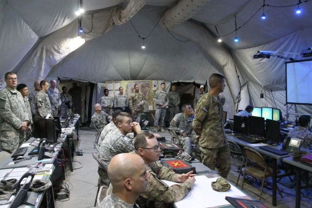 Soldiers, from the 2nd Brigade Combat Team, 1st Armored Division leverage Warfighter Information Network-Tactical, the Army's tactical communications network backbone to enable mission command and advanced network communications in the brigade main command post during Network Integration Evaluation 16.1 on Fort Bliss, Texas, and White Sands Missile Range, N.M., Sept. 23, 2015.