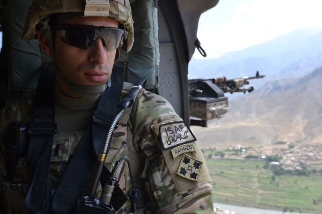 U.S. Army 1st. Lt. Florent A. Groberg, officer in charge for personal security detail, 4th Brigade Combat Team, 4th Infantry Division, enjoys the view from a UH-60 Black Hawk helicopter traveling over Kunar province, July 16, 2012.
