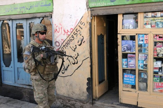 Then-1st Lt. Florent Groberg, platoon leader of 4th Platoon, Company D, 2nd Battalion, 12th Infantry Regiment, Task Force Lethal, patrols the city streets of Asad Abad, Afghanistan, Feb. 9, 2010. The unit was there to perform a pre-meeting security check of the area.