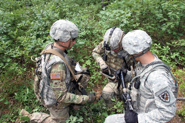 Soldiers from the Fort Benning Experimental Force, 1st Battalion, 29th Infantry Regiment assess capabilities that enable mission command, during the E15 field-based risk reduction event at Fort Dix, New Jersey, in July.