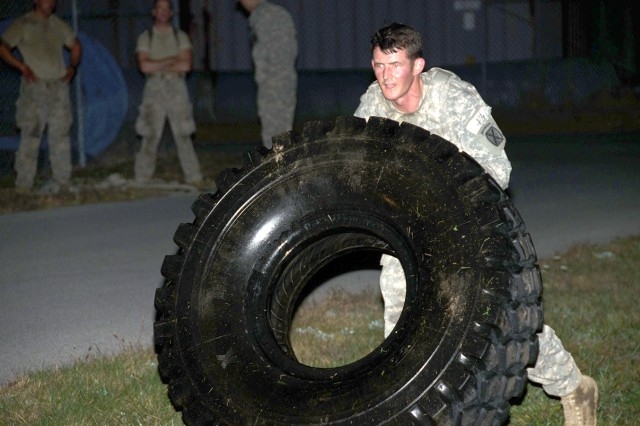 First Lt. Victor Farrar, adjutant for 1st Brigade Combat Team, 10th Mountain Division (LI), conducts tire flips Oct. 7 at Fort Drum during the Mountain Athlete Warrior portion of a division-hosted Best Ranger assessment.