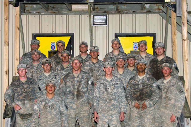 Candidates of the 10th Mountain Division (LI) Best Ranger assessment pose for a photo after completing all of the day's scheduled events Oct. 7 at Fort Drum. This 24-hour assessment is the first of many the division plans to host before choosing the Soldiers who will represent 10th Mountain Division during next year's Army Best Ranger Competition at Fort Benning, Ga.