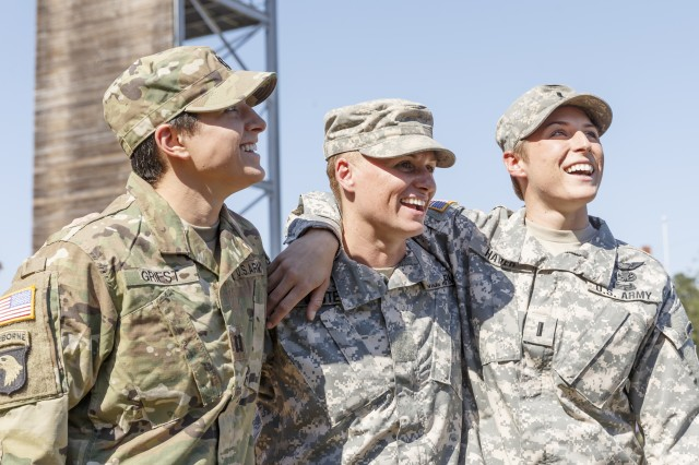 Maj. Lisa Jaster, center, celebrates her graduation Friday from the Army Ranger School with fellow West Point graduates and Active Duty officers Capt. Kristen Griest, 26, and 1st Lt. Shaye Haver, 25. Griest and Haver were the first two omen to graduate the grueling combat leadership course and earned their Ranger Tabs in August.