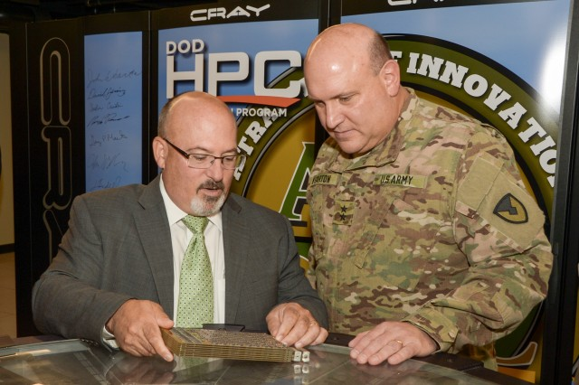 Gary Martin, left, program executive officer for command, control, communications - tactical, talks with Maj. Gen. John F. Wharton, commanding general of the U.S. Army Research, Development and Engineering Command, during the Excalibur supercomputer ribbon-cutting ceremony at Aberdeen Proving Ground, Md., Oct. 16, 2015.