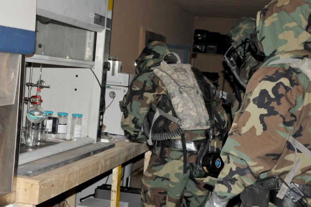 Chemical, biological, radiological, nuclear and explosives-specialized Soldiers inspect and log their findings during Network Integration Evaluation 16.1 on Fort Bliss, Texas, Oct. 4, 2015.