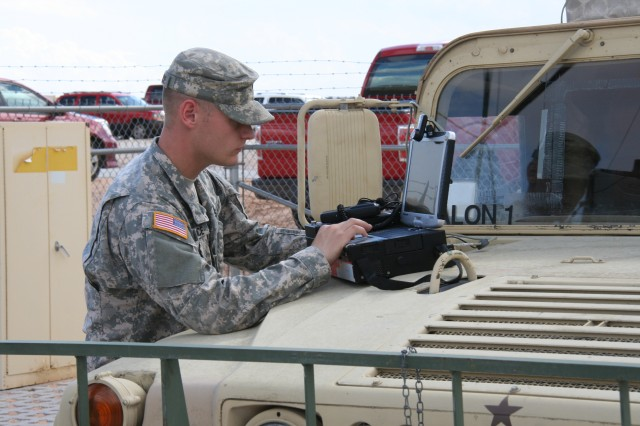 A Soldier, from the Army's 20th Chemical, Biological, Radiological, Nuclear, Explosives Command, uses a Global Rapid Response Information Package for quick reach-back to exchange critical data and confirm potentially dangerous contaminants during Network Integration Evaluation 16.1 on Fort Bliss, Texas, Sept. 23, 2015.