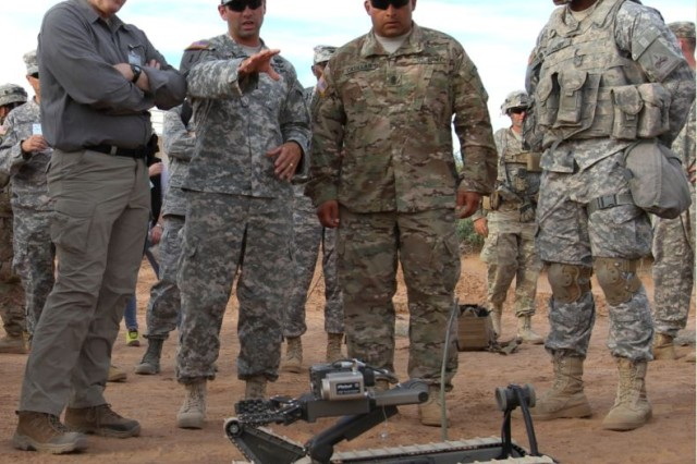Under Secretary of Defense for Acquisition, Technology and Logistics, Hon. Frank Kendall (far left) received Soldier demonstrations and feedback on what the various ground robotics are capable of during Network Integration Evaluation 16.1 at Fort Bliss, Texas.
