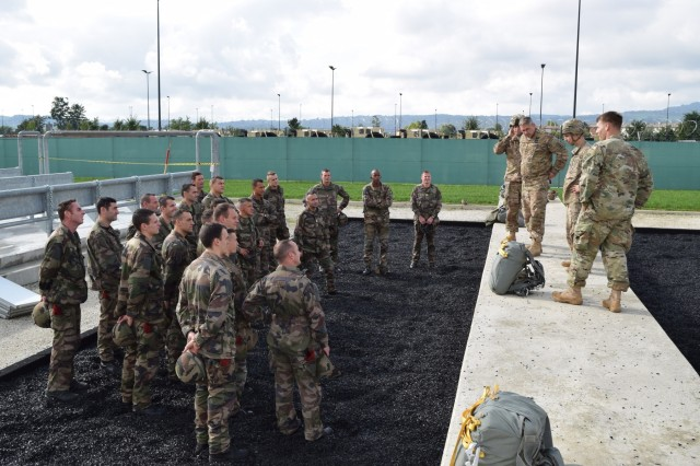 U.S. Army jumpmasters, assigned to the 54th Brigade Engineer Battalion, 173rd Airborne Brigade, conduct training with paratroopers from the French 11th Parachutist Brigade's 35th Parachutist Artillery Regiment, Oct. 16, 2015, before a joint airborne operation at Aviano Air Base, Italy. The 173rd Airborne Brigade hosted paratroopers from the French 11th Parachutist Brigade's 35th Parachutist Artillery Regiment to increase interoperability. (U.S. Army photo by Sgt. Jason Hackworth)