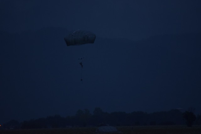 A U.S. Army paratrooper, assigned to the 173rd Airborne Brigade, prepares to land, Oct. 16, 2015, during a joint airborne operation with the French 11th Parachutist Brigade's 35th Parachutist Artillery Regiment on Juliet Drop Zone near  Aviano, Italy. The 173rd Airborne Brigade, based in Vicenza, Italy, is the U.S. Army contingency response force in Europe and is capable of deploying ready forces to conduct the full range of military operations across the U.S. European, Africa and Central Commands' areas of operations within 18 hours. (U.S. Army photo by Jason Hackworth)
