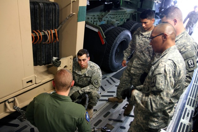 Soldiers with 5th Battalion, 5th Air Defense Artillery conducted a joint operation training mission with the 62nd Airlift Wing on Joint Base Lewis-McChord, which included air loading the Land Based Phalanx Weapons System (LPWS) onto a C-17 aircraft, Oct. 1, 2015.