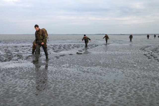 Soldiers from the U.S. 54th Brigade Engineer Battalion, Dutch 41st Armored Engineer Battalion and the Belgian army's 11th Engineer Battalion participated in traditional Dutch mud flat walking, rucking 10 kilometers during low tide at the Wadden Sea on Oct. 14.